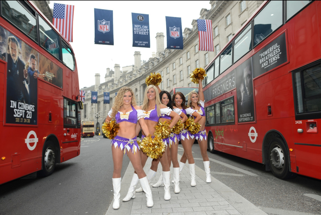 Vikings cheerleaders playing in traffic - hope they know the traffic goes the other direction :)